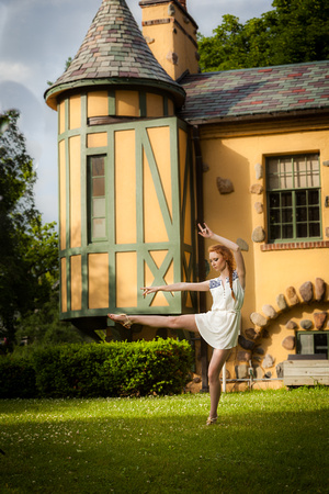 photograph of a dancing model and a yellow castle