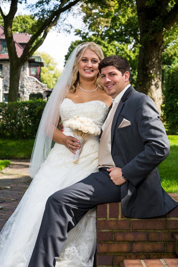 bride sitting on groom's knee