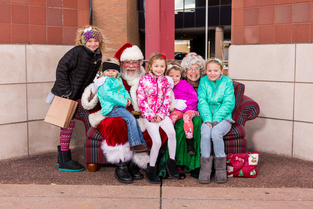 picture of sisters with Santa and Mrs Claus