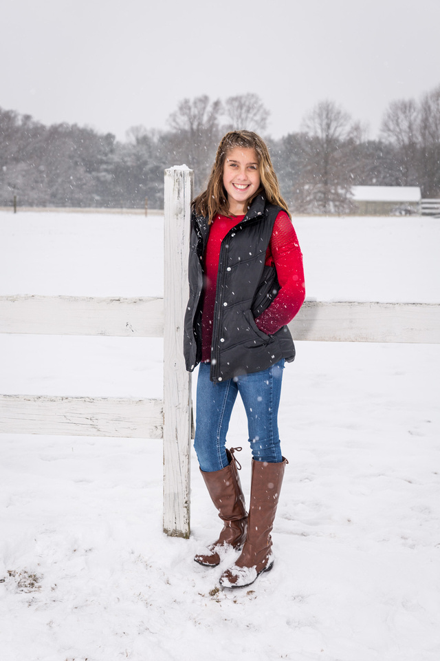 picture of a young girl in boots in the snow