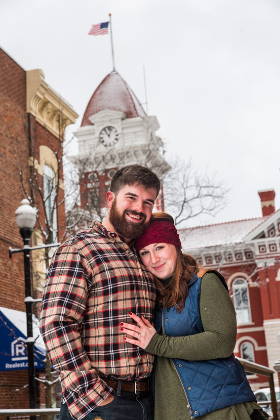 picture of engagement couple with city hall in the background