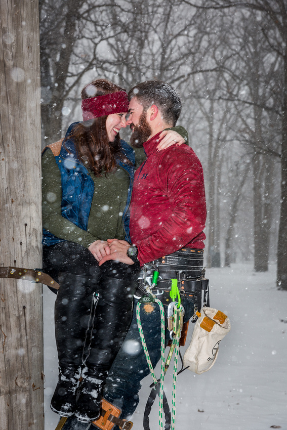 image of couple holding each other in the snow