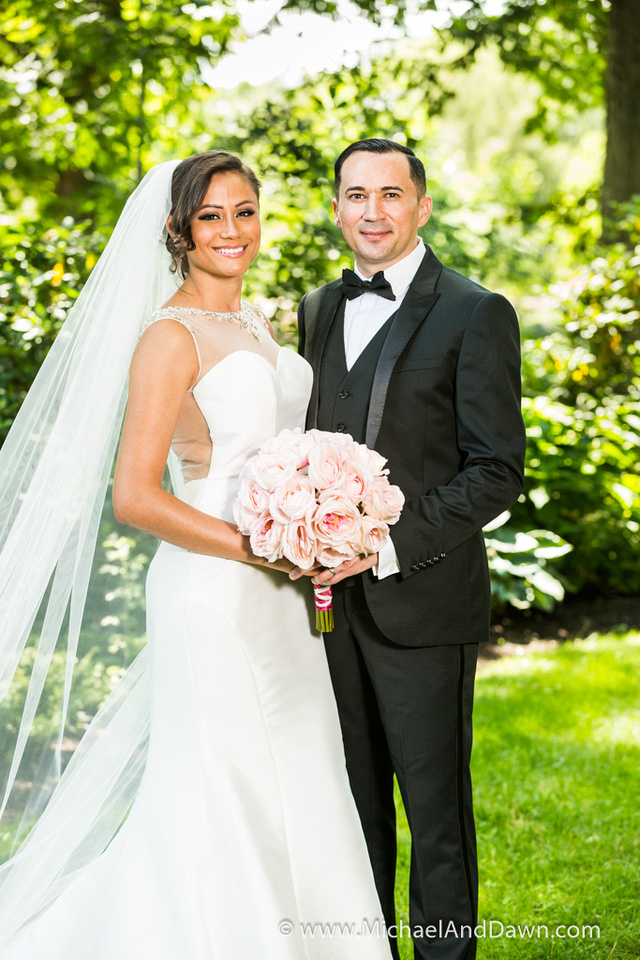 picture of bride with flowers and groom in the park