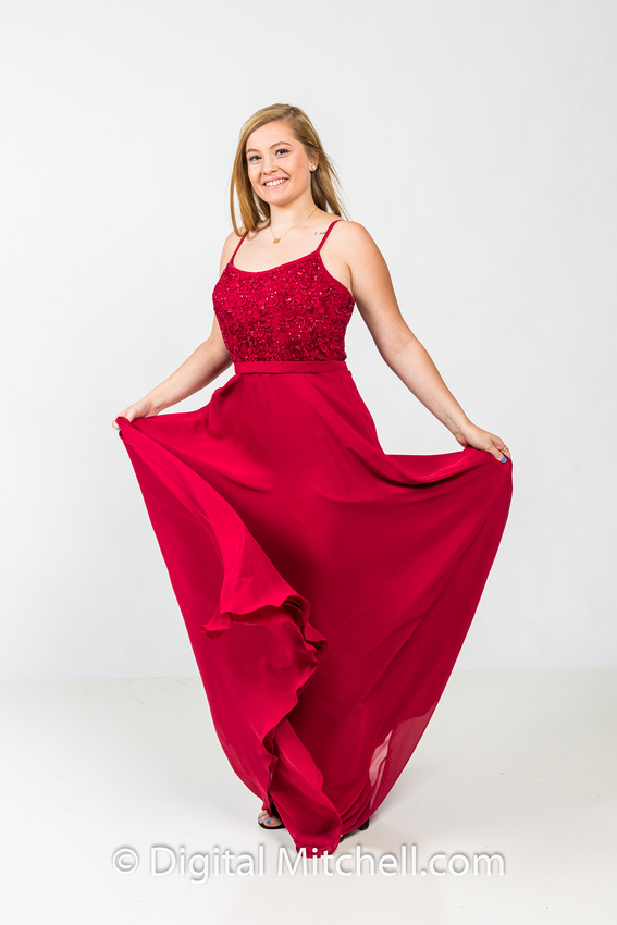 image of high school senior in red flowing dress