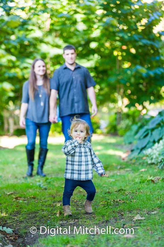 image of child with her family fall photo session