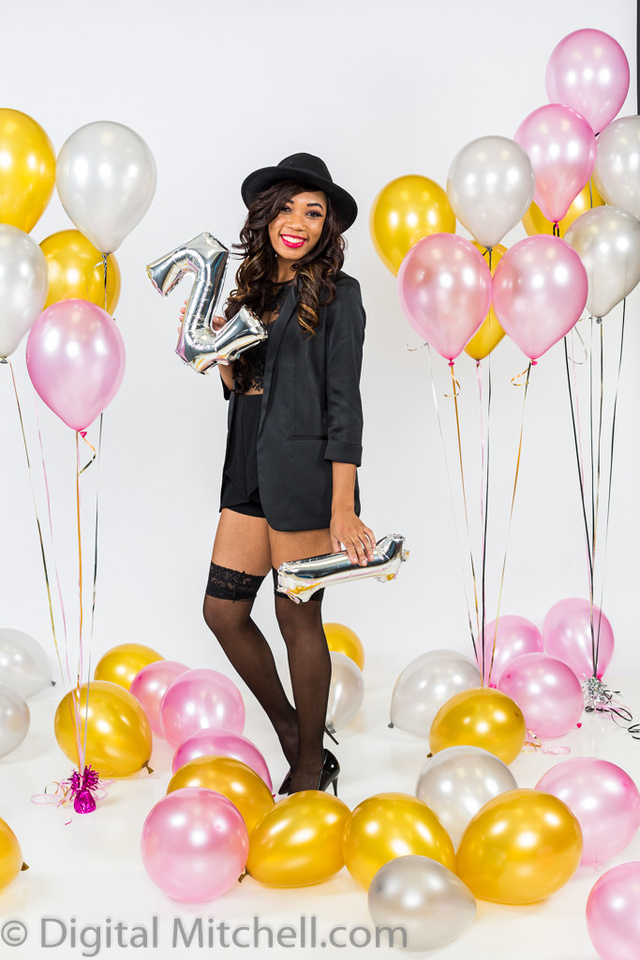 photograph of young girl with balloons on her 21st birthday