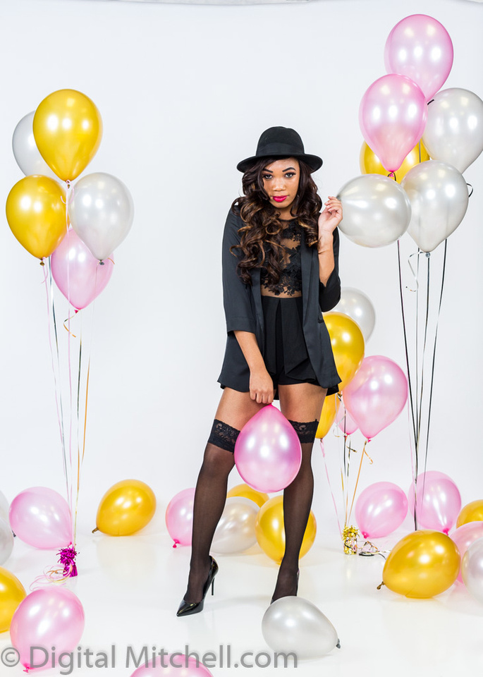 image of young african american girl on her 21st birthday with balloons and black stockings