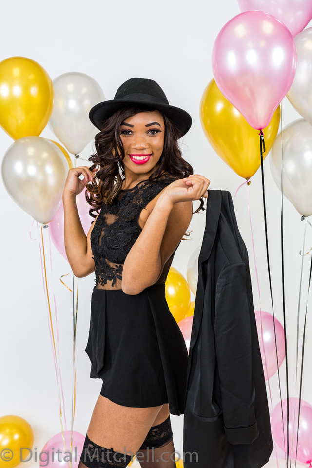 image of girl in black with balloons on her birhtday