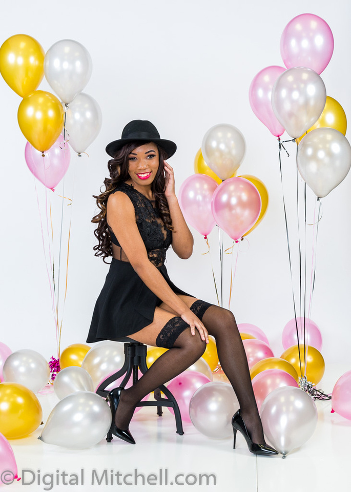 image of a young black girl  around balloons on her birhtday