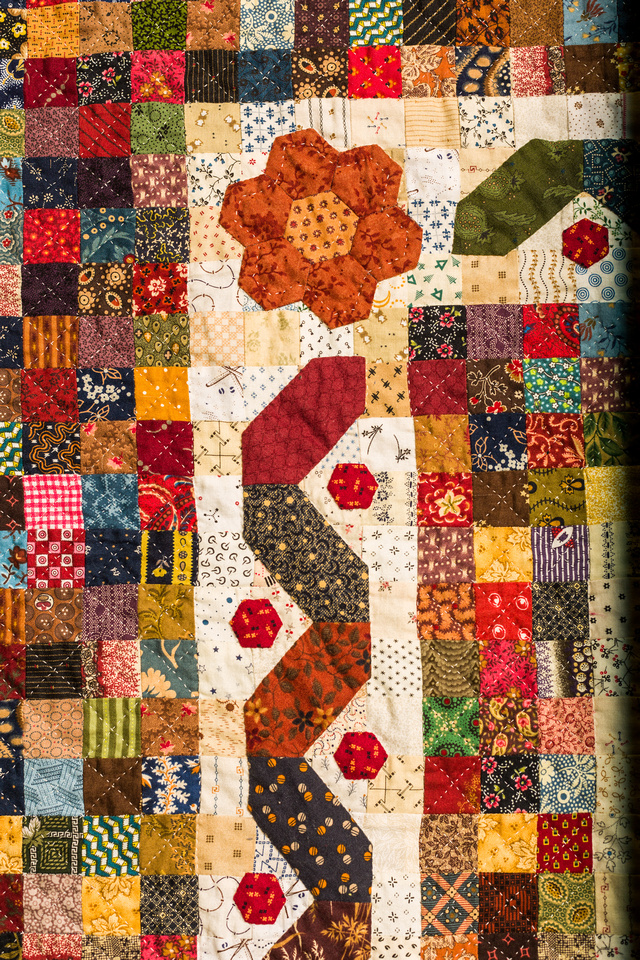 Image of a large hand made quilt