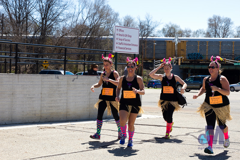 picture of the girls running over finish line at the Elkhart Amazing Race 2014