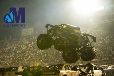 photograph of monster truck jumping