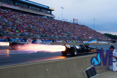 photograph of jet drag racing car with flame