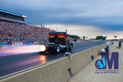 photograph of jet drag racing semi with flames