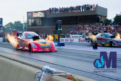 photograph of drag racing car with fire