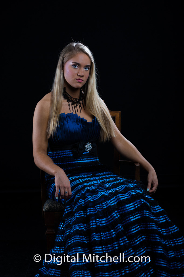 photograph of Erika in a blue dress sitting in a chair