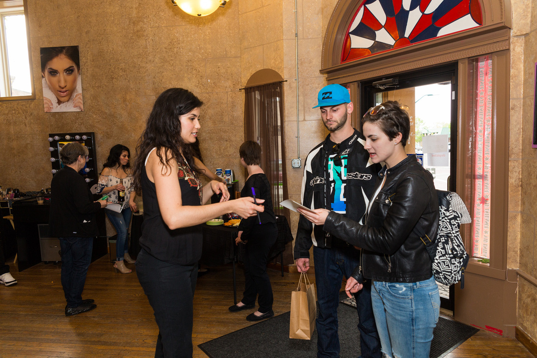 picture of artist greeting guests