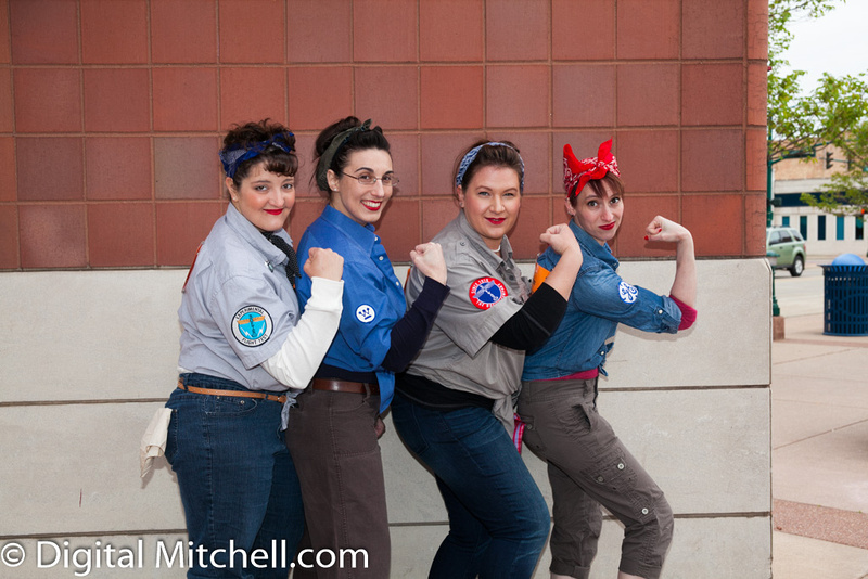 photograph of racers dressed up as Rosie the Riveters