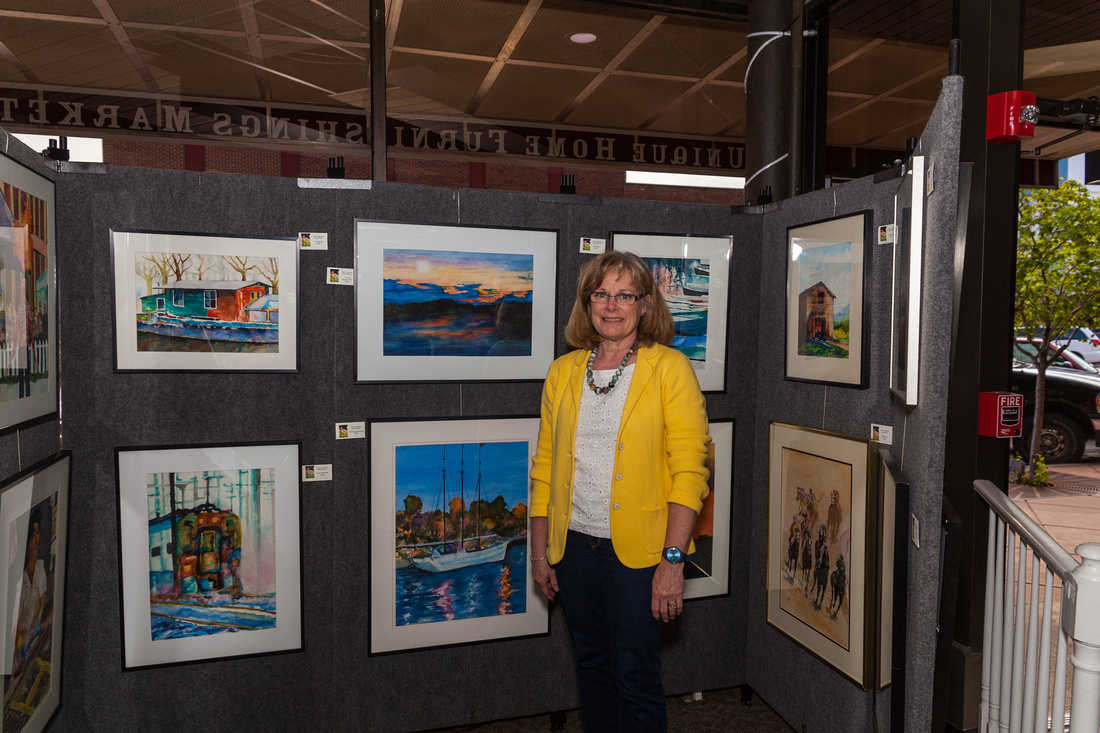 picture of artist with her paintings