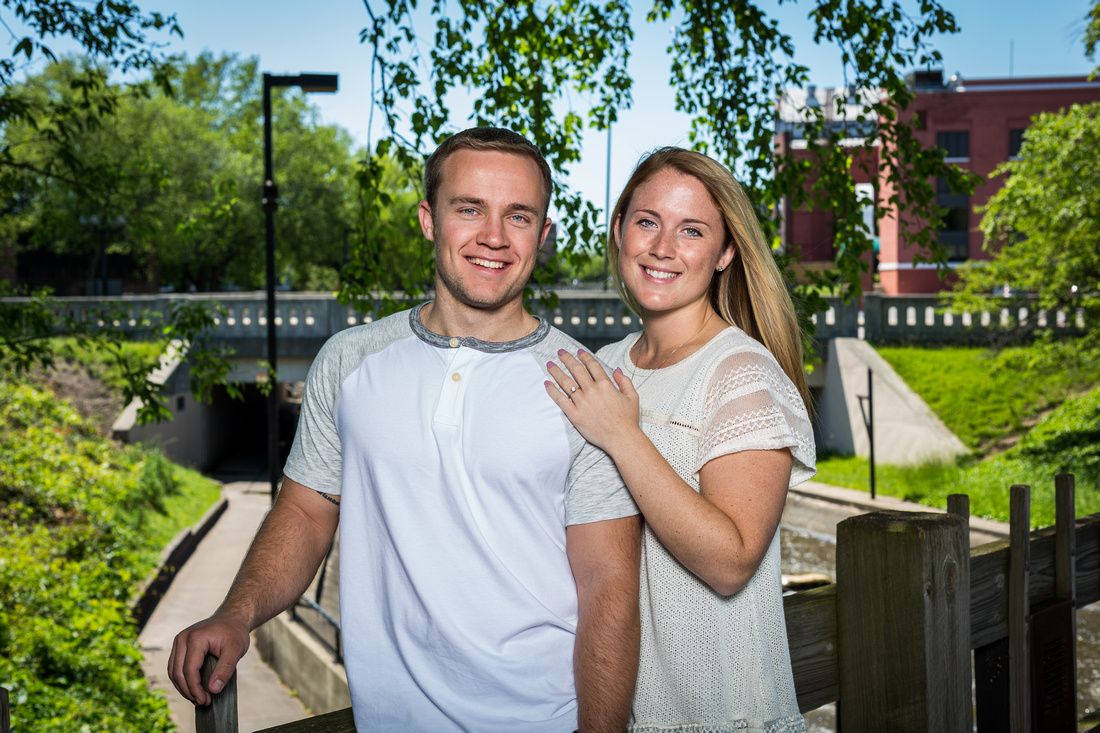 photograph of engaged couple overlooking the river