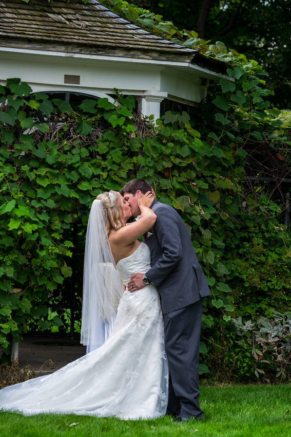 photo of the bride and groom kissing