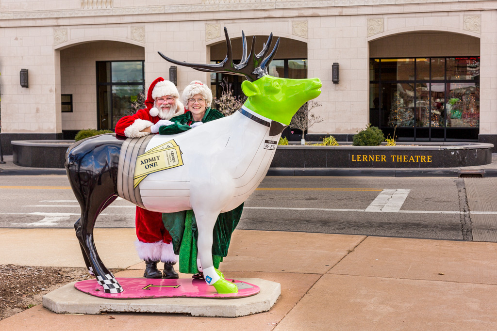 picture of an Elk with Santa and Mrs. Claus