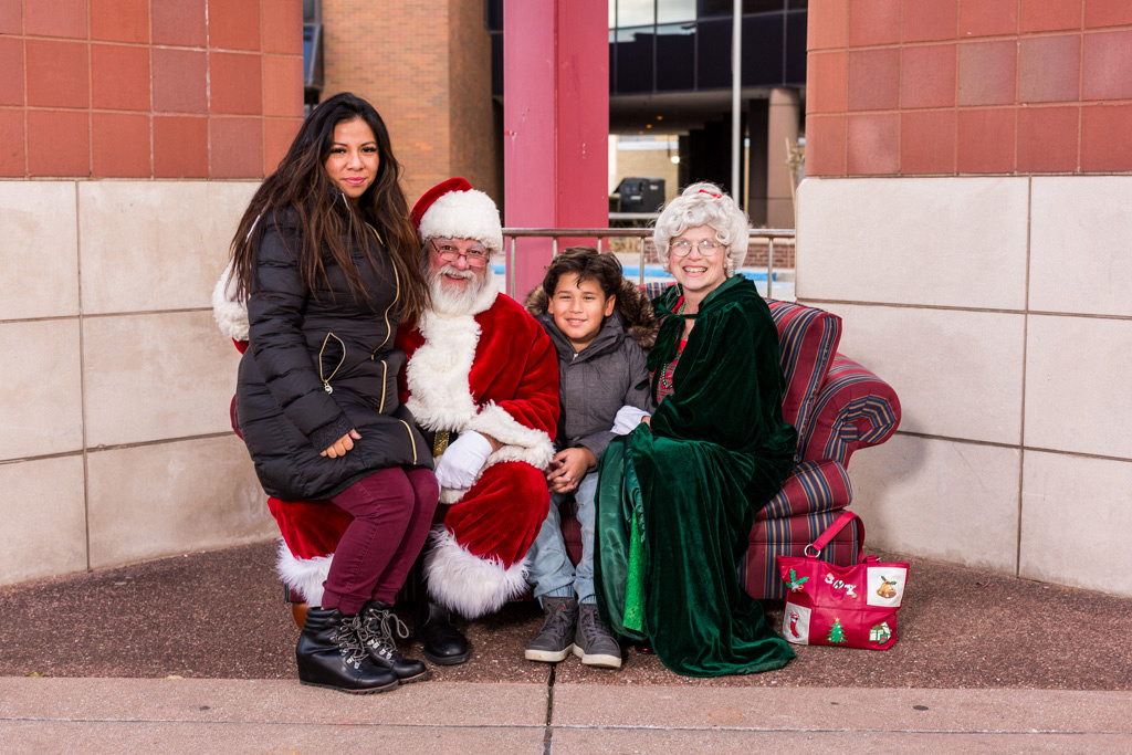 picture of mom and son with Santa