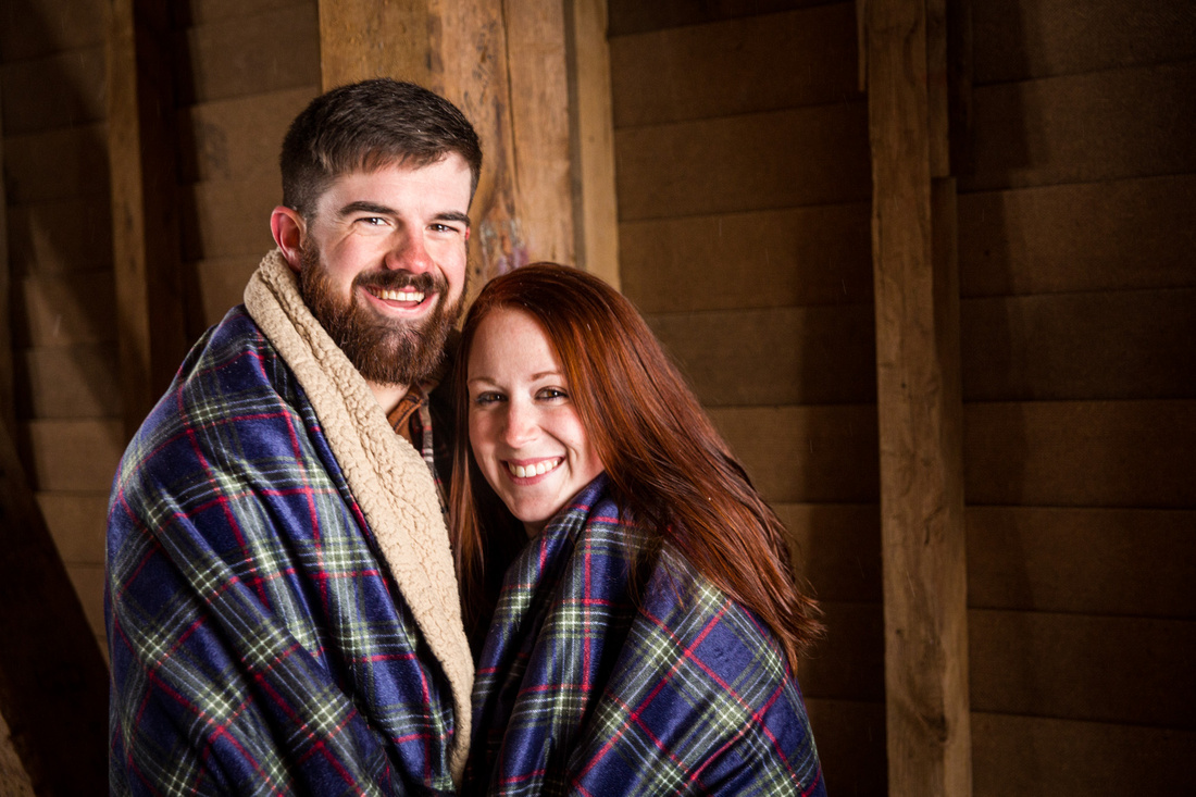 picture of a couple wrapped in blanket during  engagement photo session