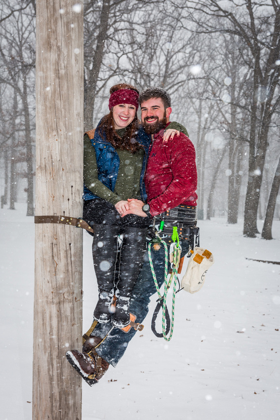 photograph of engaged couple on a poll climb