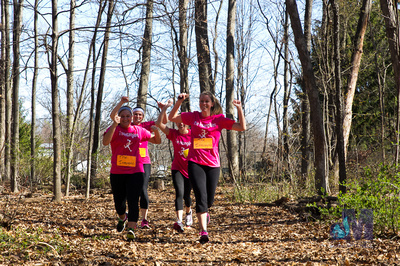 picture of girls running through the woods at Elkhart Amazing Race 2014