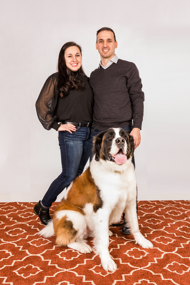 photograph of two parents with their dog