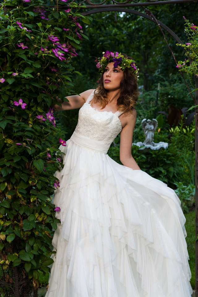picture of bride in a wedding dress surrounded by purple flowers