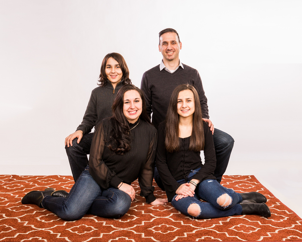 Portrait of the family sitting and kneeling