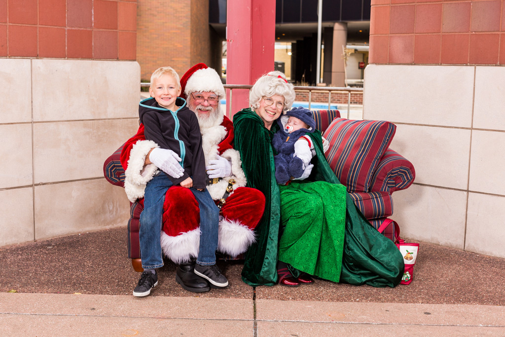 picture of a sleeping baby with Santa and Mrs. Claus