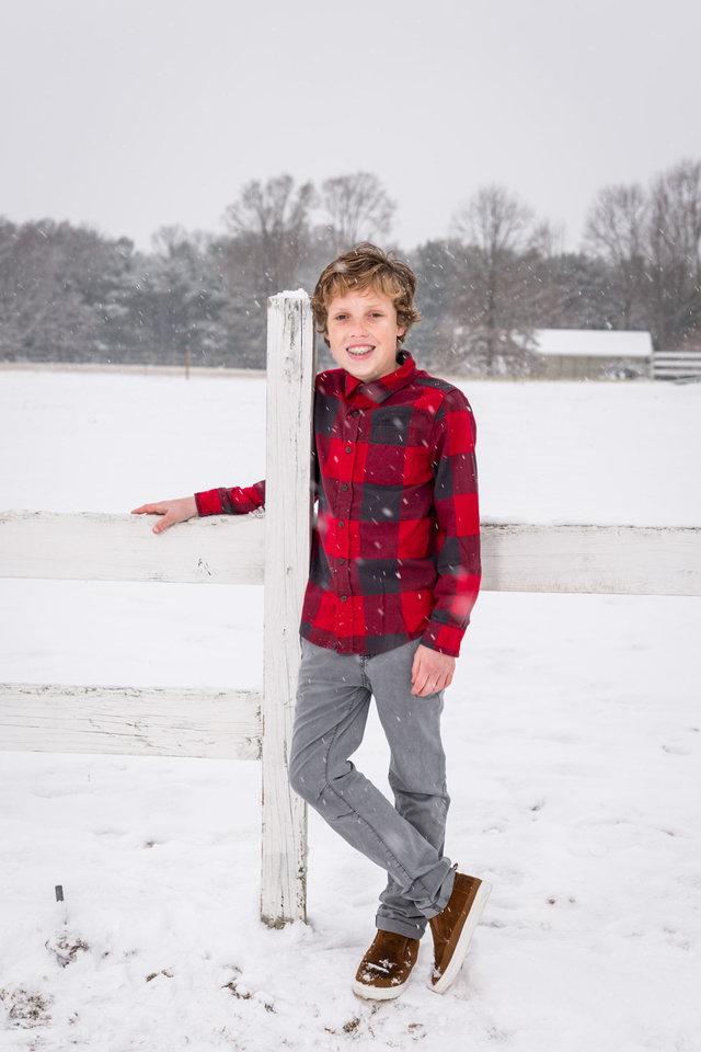 picture of boy in red against the snow