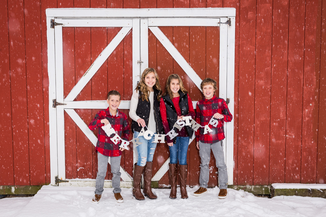 picture of kids in front of a red barn