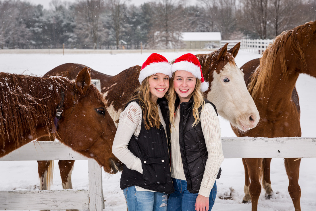picture of two girls and horses