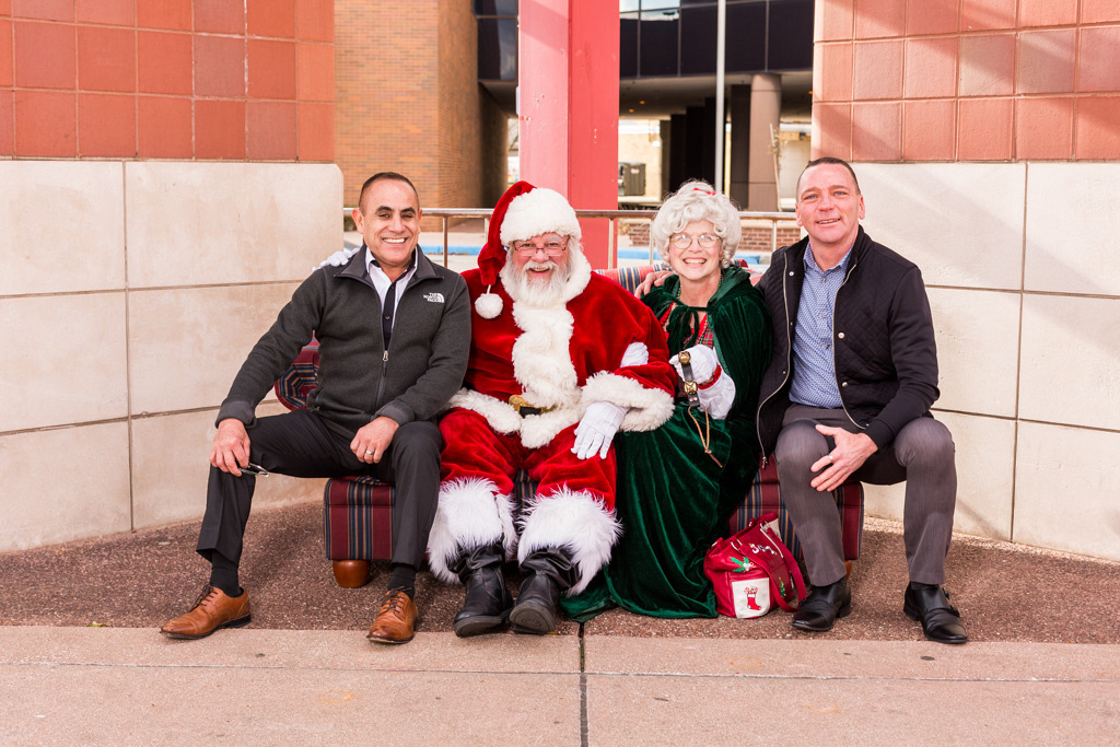 picture of adults with Santa