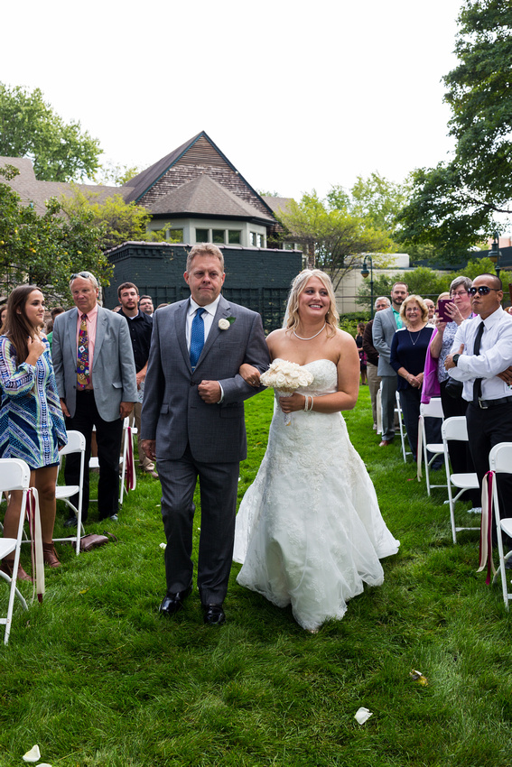 photograph of the bride being walked down the isle by her father