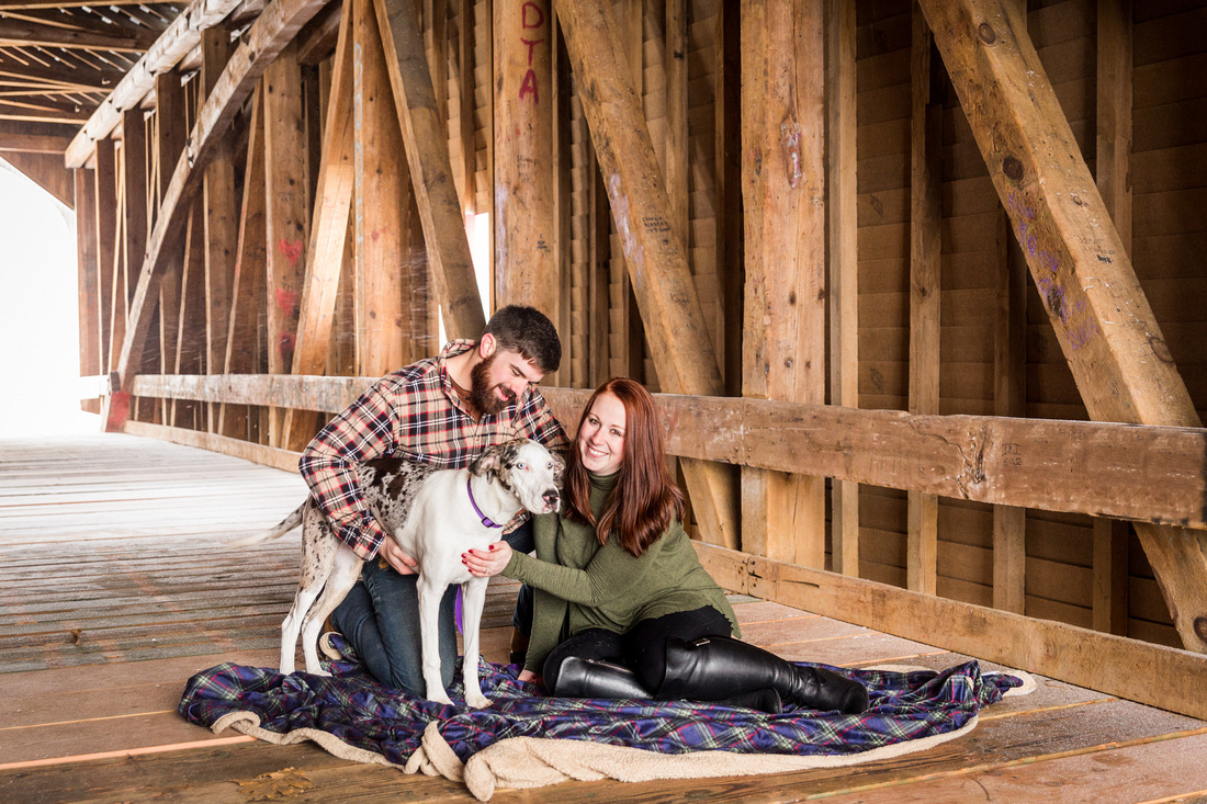 picture of dog with couple during engagement photo session