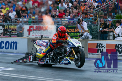 photograph of drag racing motorcyle with fire