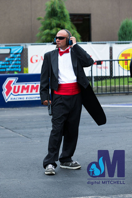 photograph of the track official in a tuxedo